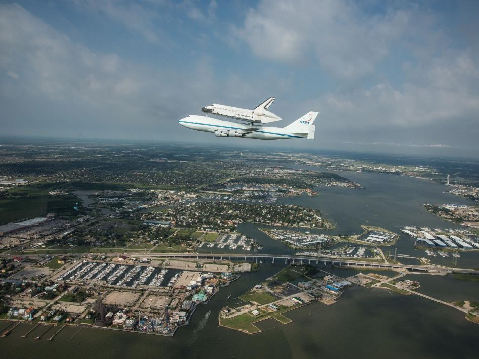 Space Shuttle Endeavour is ferried by NASA's Shuttle Carrier Aircraft (SCA) over Houston, Texas on September 19, 2012. NASA pilots Jeff Moultrie and Bill Rieke are at the controls of the Shuttle Carrier Aircraft.