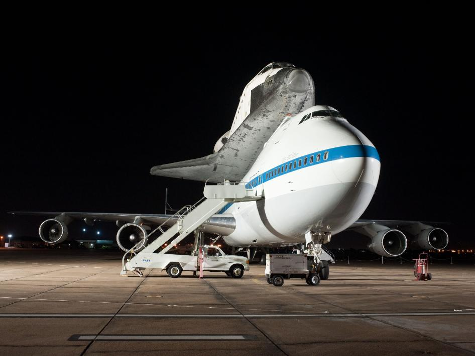 Space Shuttle Endeavour and NASA's Shuttle Carrier Aircraft (SCA) at Ellington Field in the late evening hours of September 19, 2012 before it departs for California.