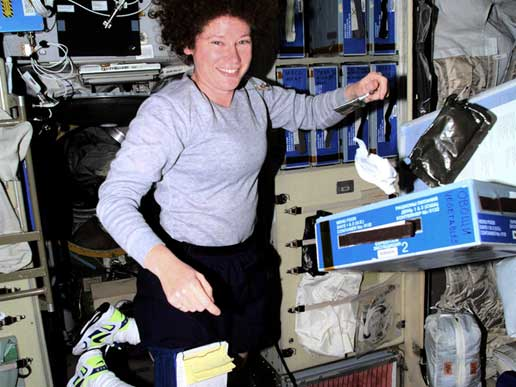 Expedition 2 Flight Engineer Susan Helms floats next to a food locker
