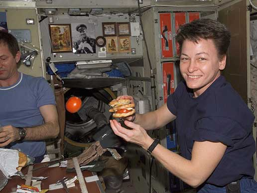 Expedition 5 crewmembers Sergei Treschev, left, and Peggy Whitson