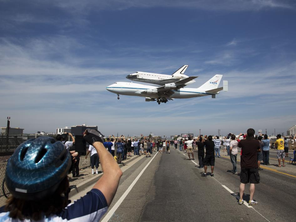 The space shuttle Endeavour, atop the Shuttle Carrier Aircraft, or SCA, lands at Los Angeles International Airport on Tuesday, Sept. 21, 2012 in Los Angeles where it will be placed on public display at the California Science Center.