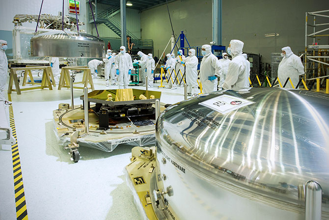 This photo shows one of the two mirrors, while the other awaits opening in its shipping canister.