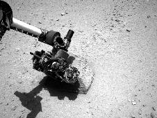 Robotic arm of NASA's Mars rover Curiosity with the first rock touched by an instrument on the arm