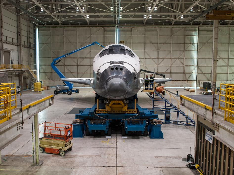The space shuttle Endeavour is seen atop the Over Land Transporter (OLT) in a hangar at Los Angeles International Airport, Monday, Sept. 24, 2012.