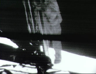 Armstrong climbs down lunar module ladder