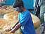 A 14-year-old blind boy named Steven is digging in a container of soil at the Maryland Science Center