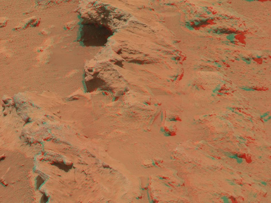 This stereo image from the Mast Camera (Mastcam) on NASA's Mars rover Curiosity shows a rock outcrop called