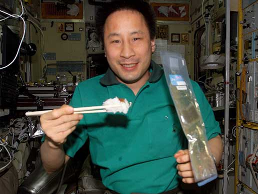 Expedition 7 crewmember Ed Lu with chopsticks.