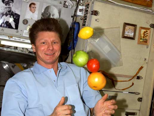 Expedition 9 crewmember Gennady Padalka with freely floating fresh fruit