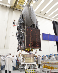 TDRS-K in the Boeing satellite factory undergoing a fit check