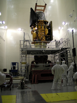 Engineers at Orbital's Satellite Manufacturing Facility in Gilbert, Ariz. place the satellite on the vibration table.