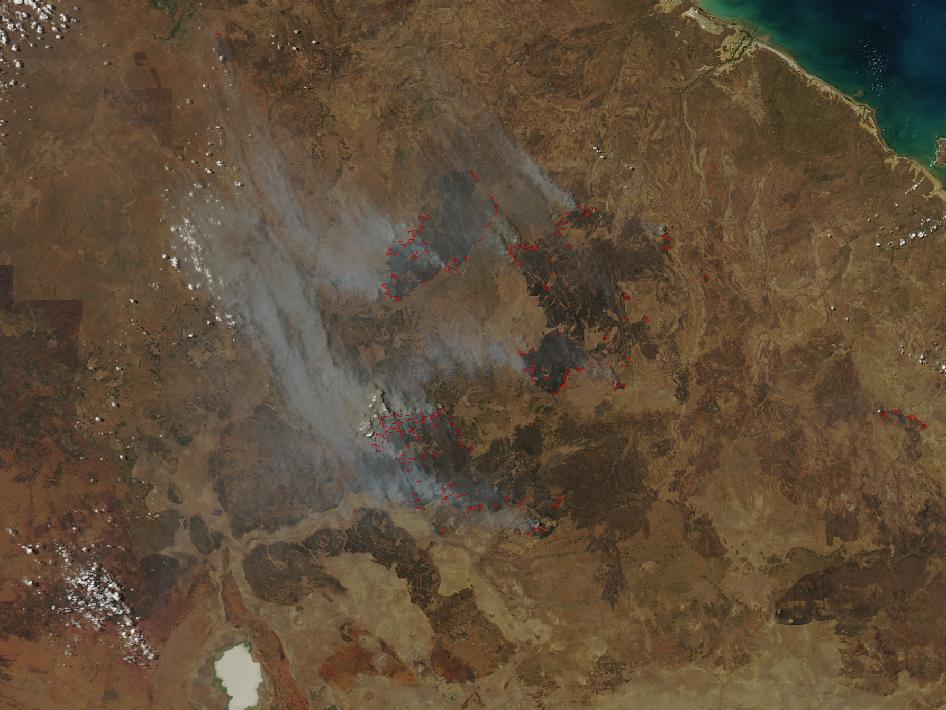 In early-October 2012, intense bushfires blazed in Australia's Northern Territory in a remote area northeast of Elliott. MODIS on NASA's Aqua satellite captured this image of smoke from the fires streaming northeast on October 6, 2012.