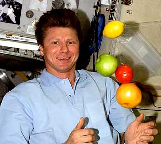 Expedition 9 Commander Gennady Padalka with floating fruit