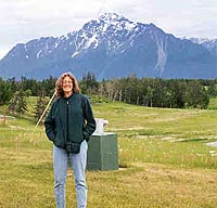 Elissa Levine standing in front of mountains