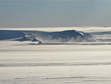 Windblown snow coming off the Pensacola Mountains in Antarctica as seen from the IceBridge DC-8 on Oct. 15.