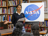 A Presentation High student introduces the speakers in front of a NASA logo