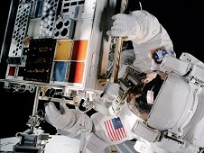 Mission Specialist Patrick Forrester opens a Materials International Space Station Experiment. (NASA)