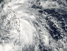 MODIS captured a visible image of Son-tinh when its center was moving through the central Philippines.