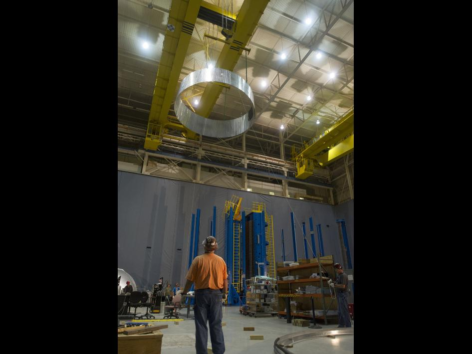 Engineers at the Marshall Space Flight Center move a pathfinder version of the adapter design for Orion and SLS.