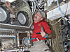 Dan Burbank works with hardware inside a glovebox on the space station