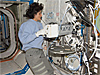 Sunita Williams inserts biological samples into the space station experiment freezer