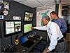 NASA Administrator Charles Bolden, left, joins Jon Olansen in a control room