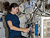 Astronaut Nicole Stott works with the Mice Drawer System on the space station