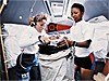 Astronauts Jan Davis and Mae Jemison prepare an experiment inside the space shuttle