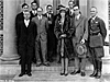 Amelia Earhart (center) stands with a group of men on steps of Langley building