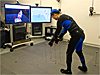 Engineer wears a suit covered with reflectors in the Virtual Environment Laboratory