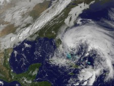 On Oct. 26, GOES-13 shows Hurricane Sandy's huge cloud extent of up to 2,000 miles while centered over the Bahamas