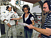 Astronaut Dave Williams tests a spacesuit with astronaut Tracy Caldwell and crew trainer Paul Dum