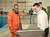 Crew trainer preparing astronaut for water survival training