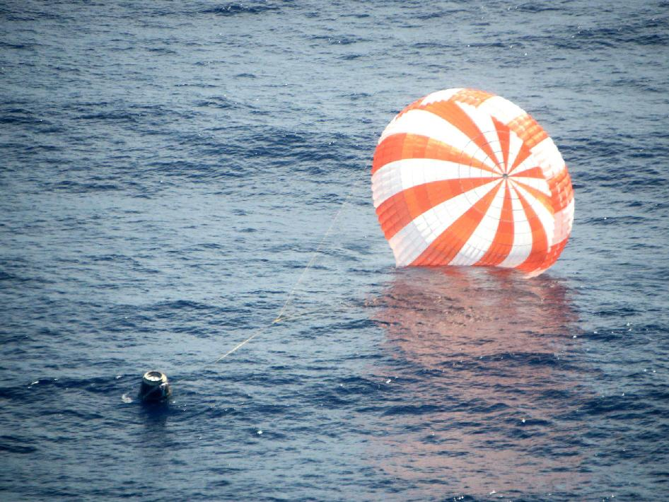 SpaceX's Dragon spacecraft is seen shortly after splashdown