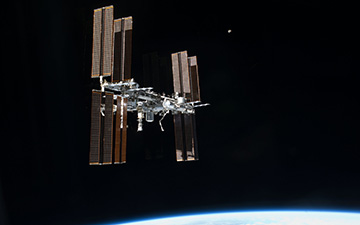 NASA's Spot the Station service sends you an email or text message a few hours before the space station passes over your house.