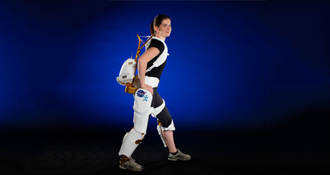 A woman demonstrates the X1 Robotic Exoskeleton