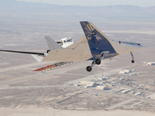 The upgraded X-48C version of Boeing's Blending Wing Body subscale research aircraft banks over Rogers Dry Lake near