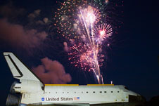 Fireworks light up as space shuttle Atlantis arrive