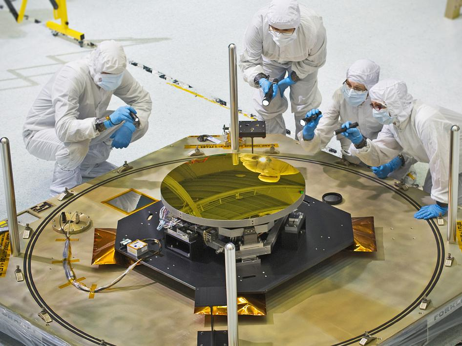 technicians inspect Webb telescope secondary mirror