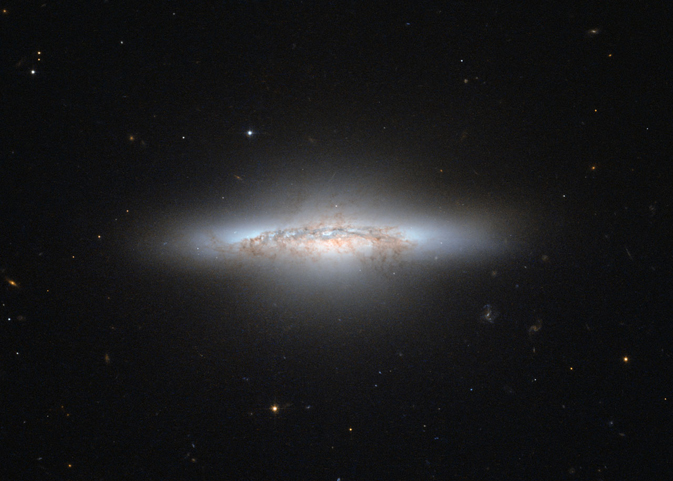 An aging galaxy, losing its spiral structure with orange and black streaks like a Hollywood explosion