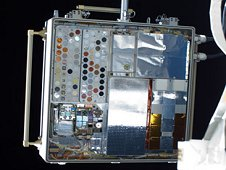 This image shows the Materials on International Space Station Experiment - 8 (MISSE-8), a test bed for materials and computing elements attached to the outside of the orbiting laboratory to evaluate the effects of atomic oxygen, ultraviolet, direct sunlight, radiation, and extremes of heat and cold. (Credit: NASA)