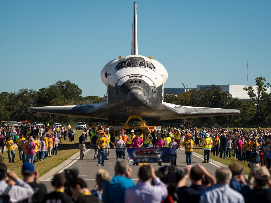 Space shuttle Atlantis is seen during its trip to its new home at the Kennedy Space Center Visitor Complex, early Friday, Nov. 2, 2012, in Cape Canaveral, Fla.