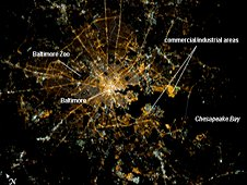 This Crew Earth Observation image shows Baltimore at night. Located on the US mid-Atlantic coastline along the terminus of the Patapsco River into Chesapeake Bay, Baltimore is the largest seaport along this part of the coast. Like many large metropolitan areas, the most brightly lit area corresponds to the highest density of buildings and typically indicates the urban core -- in this case, downtown Baltimore at image center. Highways and large arterial streets appear as bright yellow-orange lines extending outwards from the downtown area into the surrounding suburban regions. (NASA)