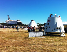 Space shuttle Atlantis, and Orion and Dragon mock-ups