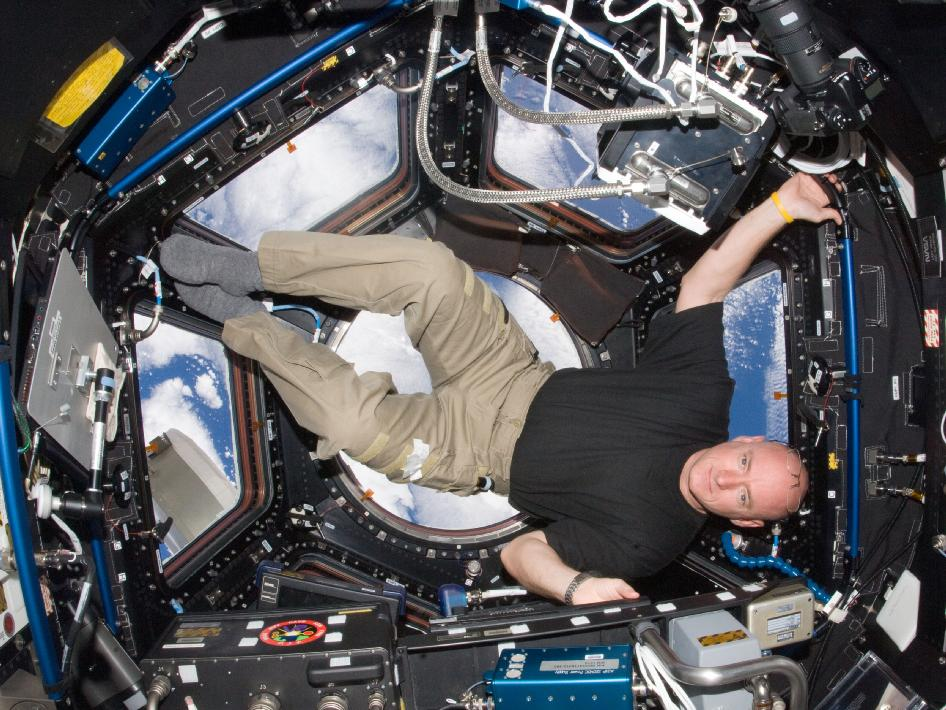 NASA astronaut Scott Kelly, Expedition 25 flight engineer, is pictured in the Cupola of the International Space Station on Oct. 14, 2010.