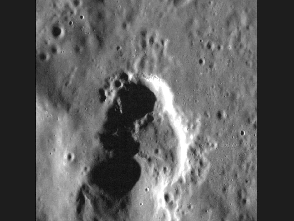 Image from Orbit of Mercury: Volcanic Vent? Vacant Void!
