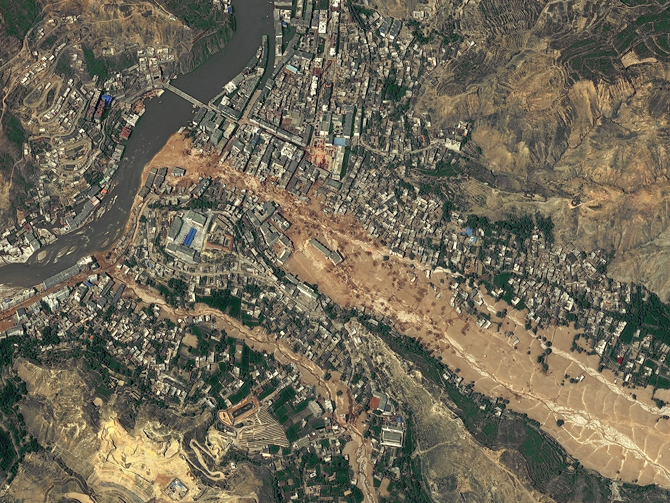 Around midnight on August 8, 2010, a violent surge of loosened earth roared down mountain slopes and slammed into quietly sleeping neighborhoods in Zhouqu County in Gansu, China.