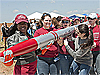 A student team from the University of Alabama carries a large rocket during the 2012 Student Launch Projects Challenge