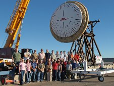 The NASA Low Density Supersonic Decelerator team gathers around the Supersonic Inflatable Aerodynamic Decelerator they are developing.