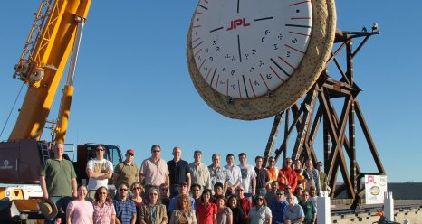 The NASA Low Density Supersonic Decelerator team gathers around the SIAD R -- a Supersonic Inflatable Aerodynamic Decelerator they are developing to assist future planetary exploration missions.